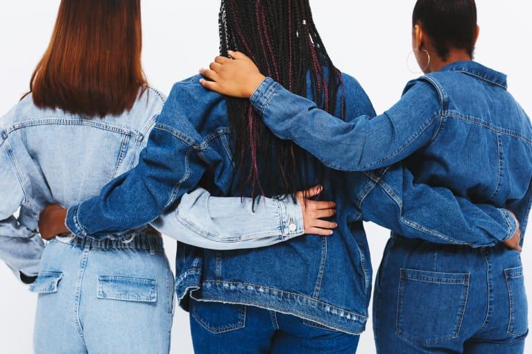 Women in Jean Jackets Linked Arm in Arm