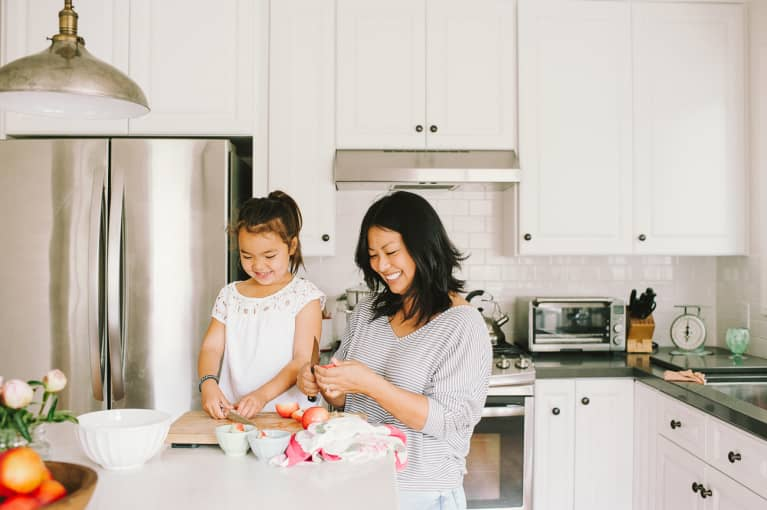 Mom and Daughter Making a Snack in The Kitchen