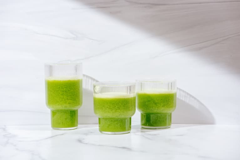 Green smoothies on a marble background