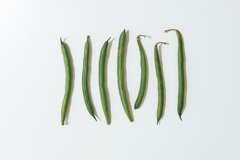 Green Beans Organized On White Background