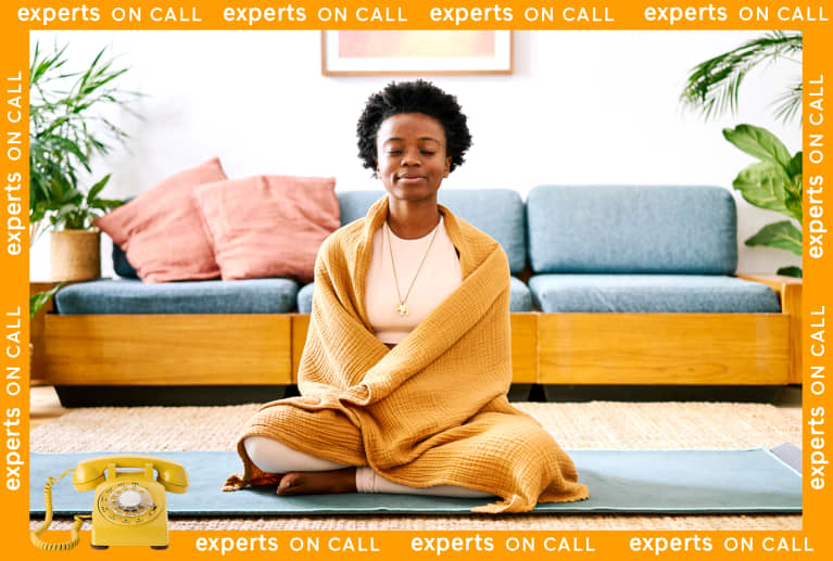 Woman Mediating At Home, Wrapped in a Cozy Blanket