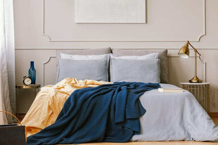 Dark Blue Blanket on a Comfortable Bed
