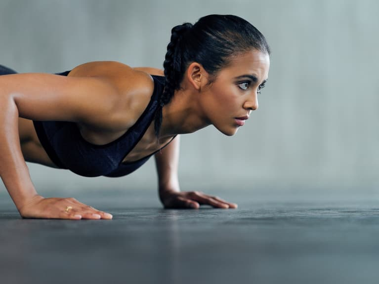 Young Woman Doing a Pushup