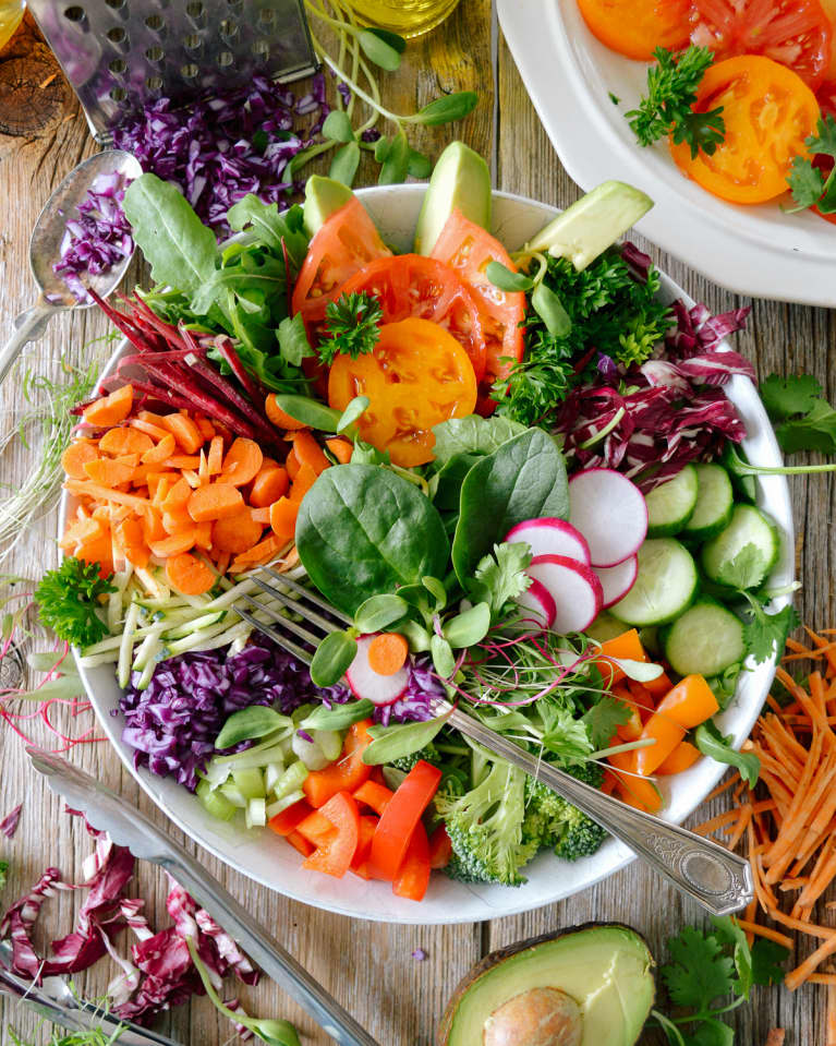 Super Salad With Spinach, Carrots, Cabbage, Radishes, Cucumbers, Peppers, Broccoli, and Tomatoes