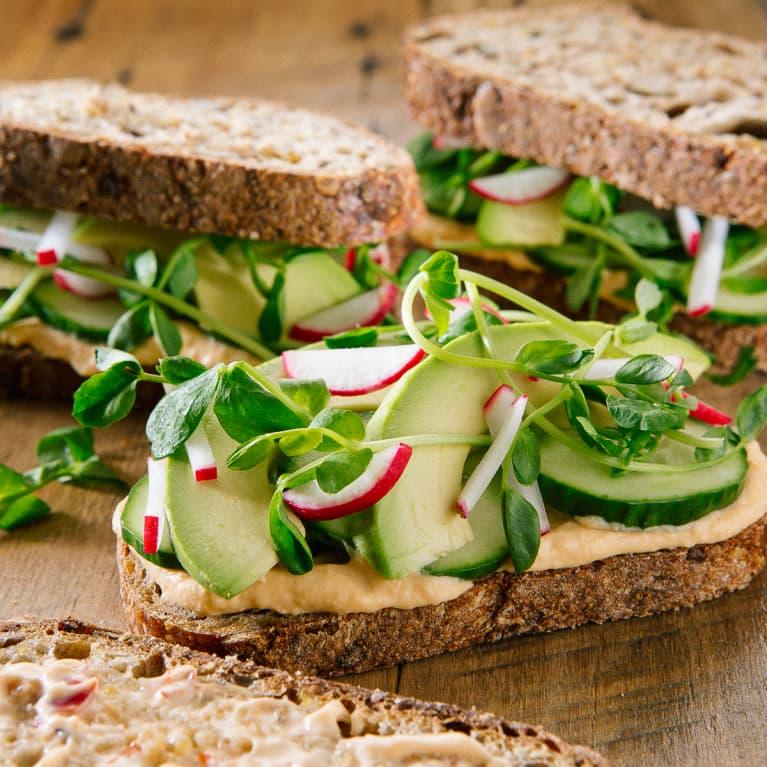 Cucumber, Avocado, Radish, Microgreens, and Hummus on Whole Wheat Bread