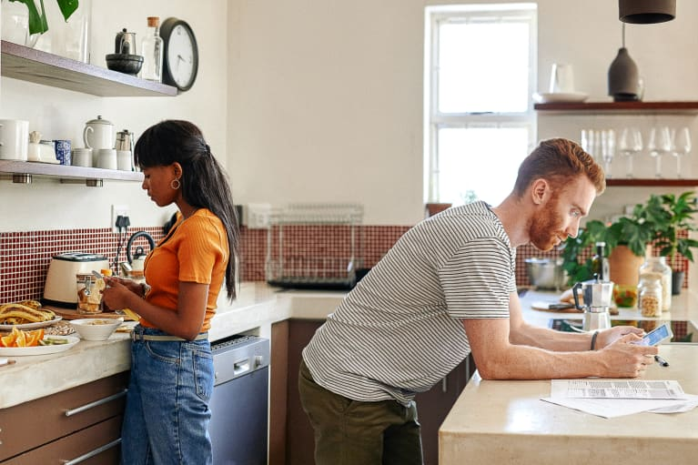 Couple in a Kitchen Doing Different Things