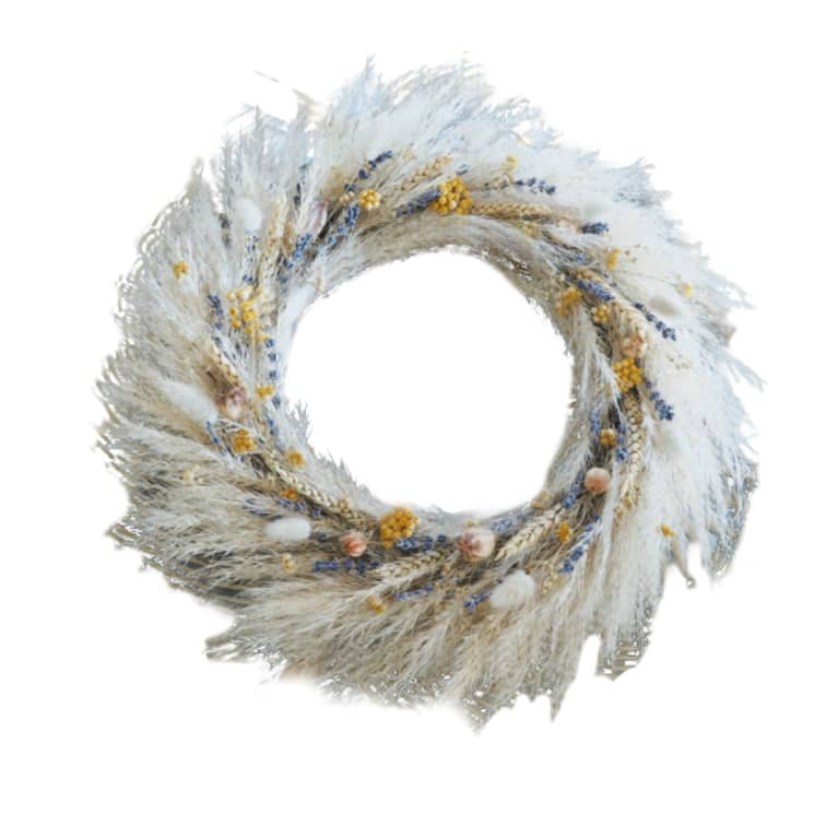 white feather wreath with yellow and purple dried flowers