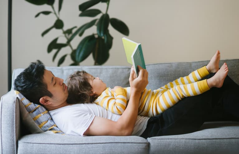 Father Reading To His Child on the Couch