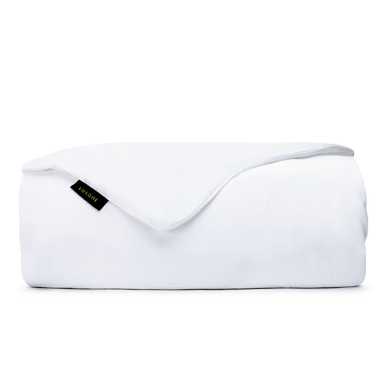 White weighted blanket with black tag, folded.