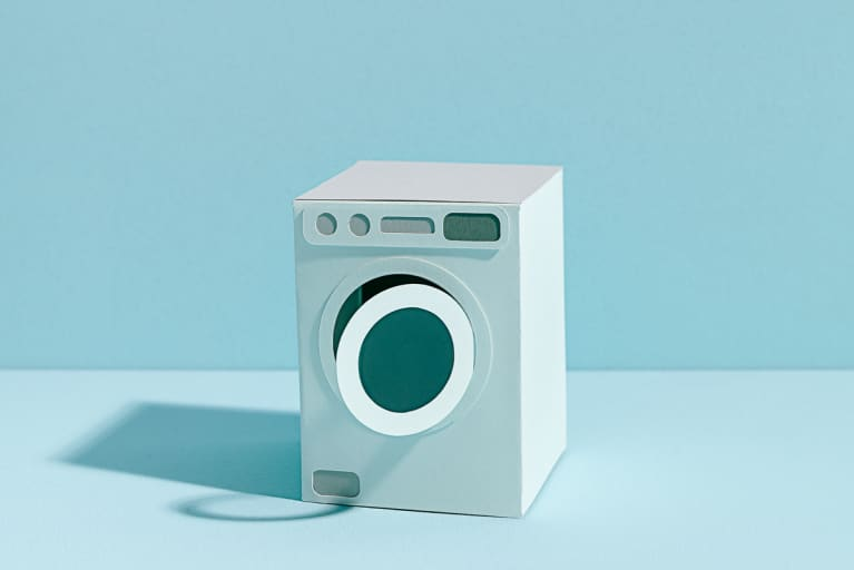 Paper Model of a Washing Machine on a Minimal Blue Background