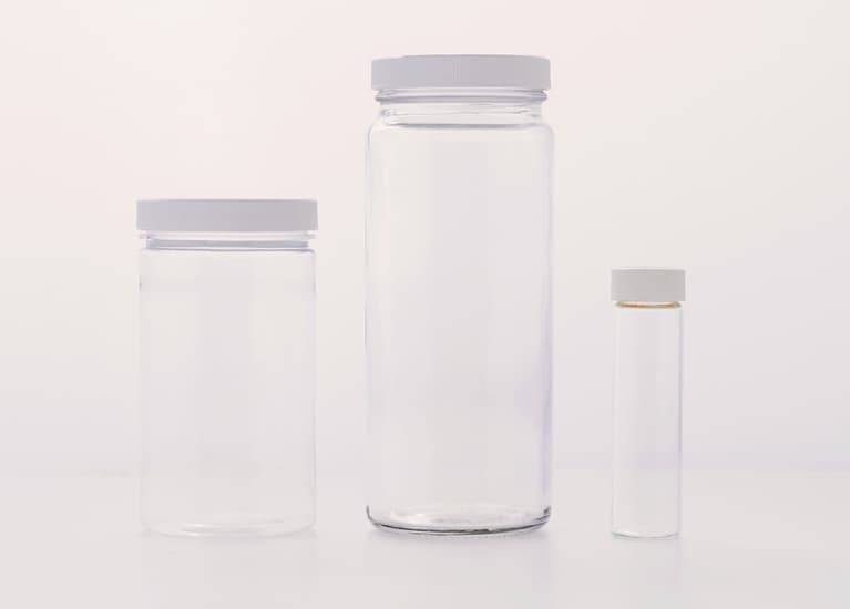 three empty plastic containers of various sizes