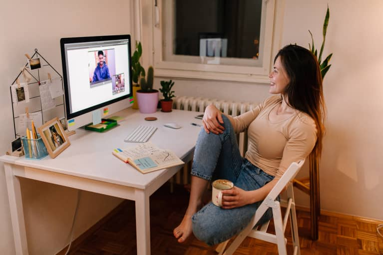 Young woman sitting at her desk on a video call