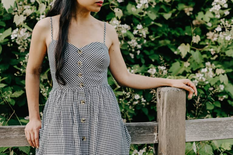 Unrecognizable Woman in a Gingham Dress Outdoors