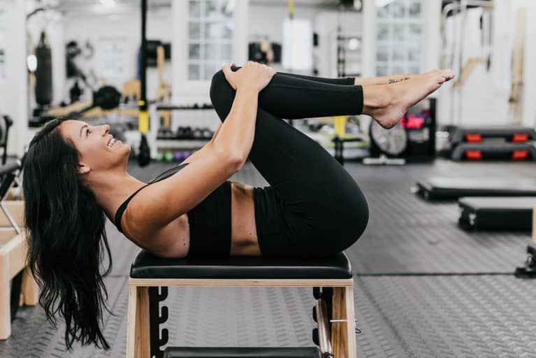 Ignite Your Core With A Pilates Move That's Way More Exciting Than Plank