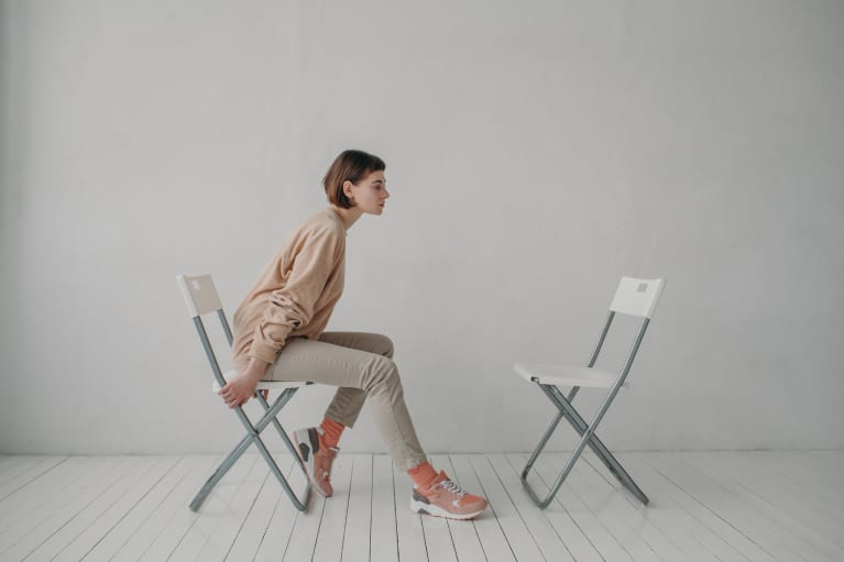 Image of person sitting alone by themselves.