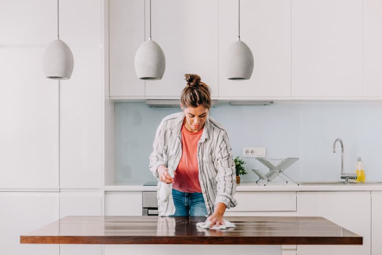 Woman Cleaning Her Kitchen Counter