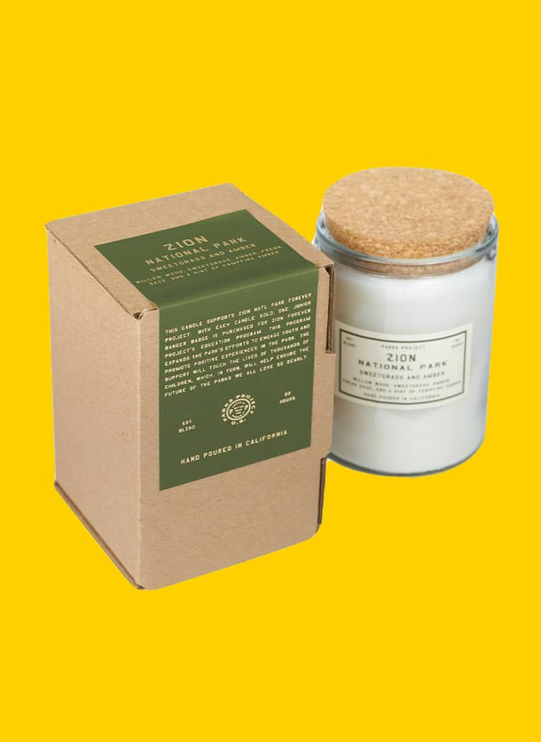 Parks Project branded candle with green label