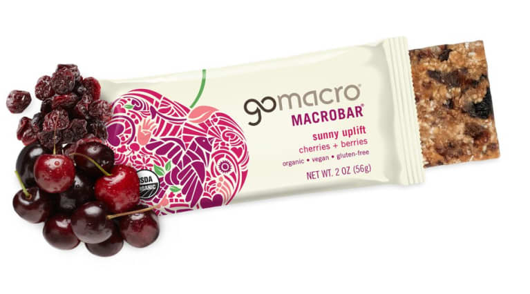 GoMacro cherries and berries bar with dried berries and fresh cherries next to the off white package.