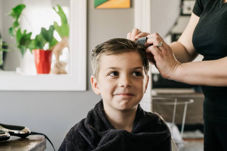 Mother Trimming Her Son's Hair at Home During Quarantine