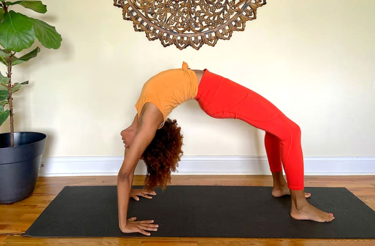 How To Do Wheel Pose To Strengthen Your Spine & Open Your Heart