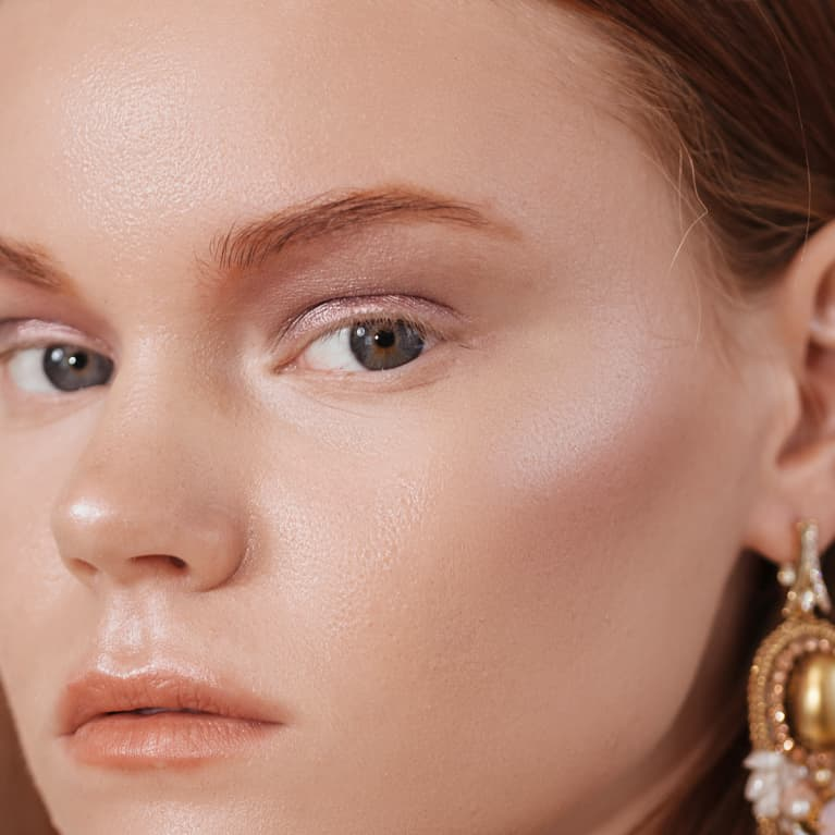 Close Up Beauty Shot of a Woman with Glowing Skin and Rosy Cheeks