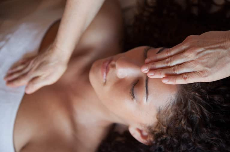 How Reiki Can Help Ease Stress & Fatigue: A Practitioner Explains