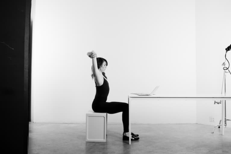 4 Easy Yoga Poses To Practice At Your Desk