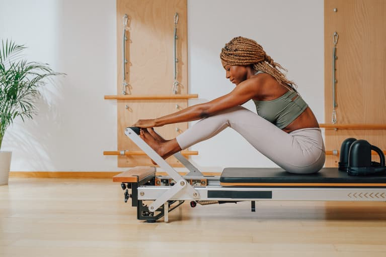 Woman Doing Pilates in a Studio