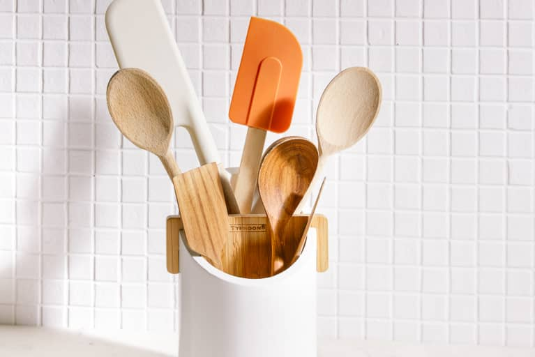 Silicone Spatulas and Wooden Spoons in a Crock on a Kitchen Counter