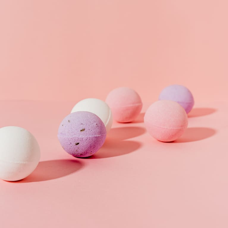 Pink, Purple, and White Bath Bombs on a Pink Background
