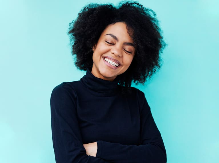 Woman smiling on blue background