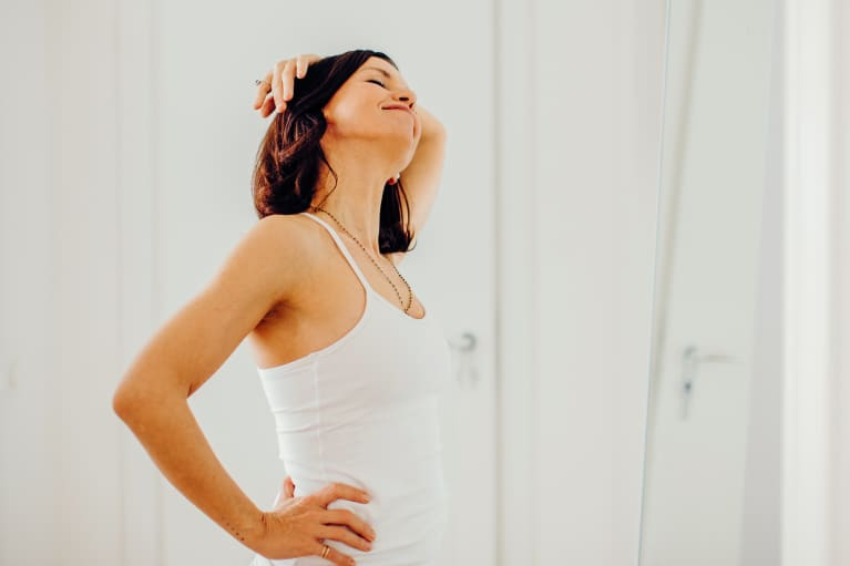 Woman Stretching Her Neck and Shoulders In The Morning