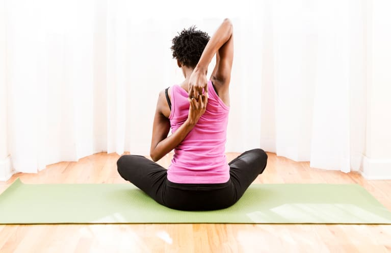 9 Tension-Relieving Yoga Postures To Soothe The Body & Mind