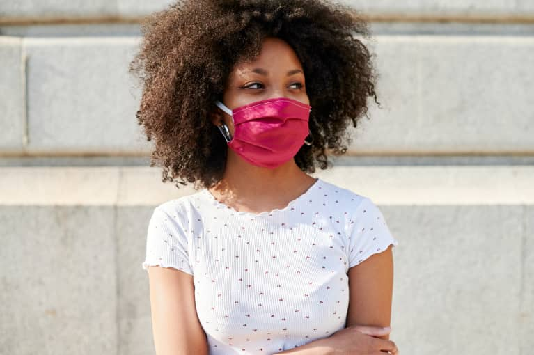 Young black woman in a mask