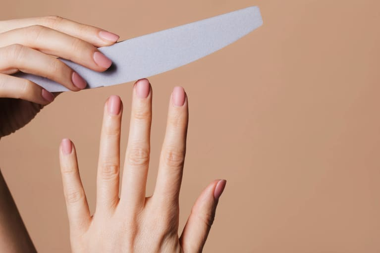 Manicure against minimal peach seamless