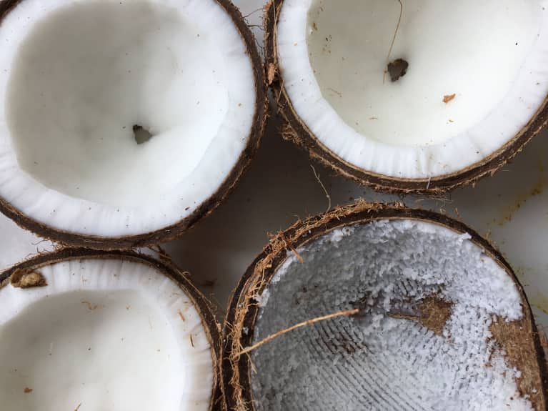 Why Coconut Oil Pulling May Be The Secret To Whiter Teeth & Better Digestion