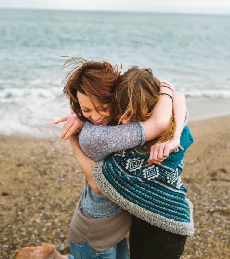 Image of two friends embracing. Human connection is a basic emotional need.
