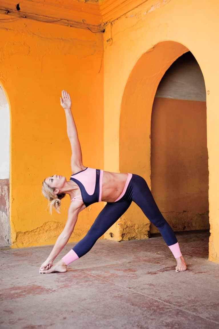 woman doing triangle yoga pose