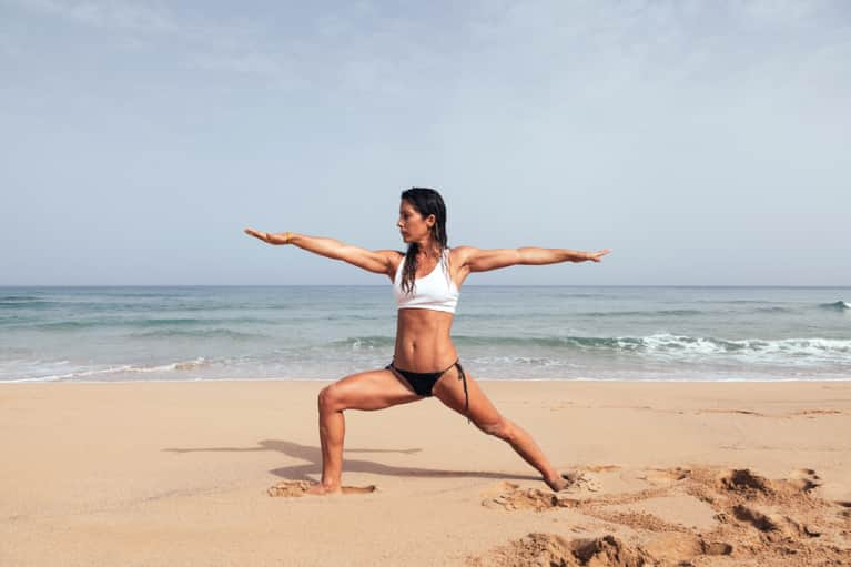 Beach Yoga: 4 Poses To Do Barefoot In The Sand