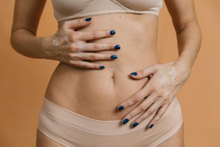 Woman holding her stomach and gut