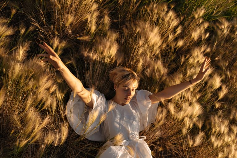 Young woman in a grassy field