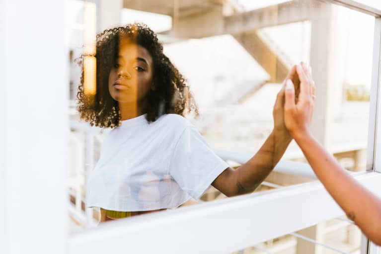 Woman Gazing at Her Reflection Outdoors