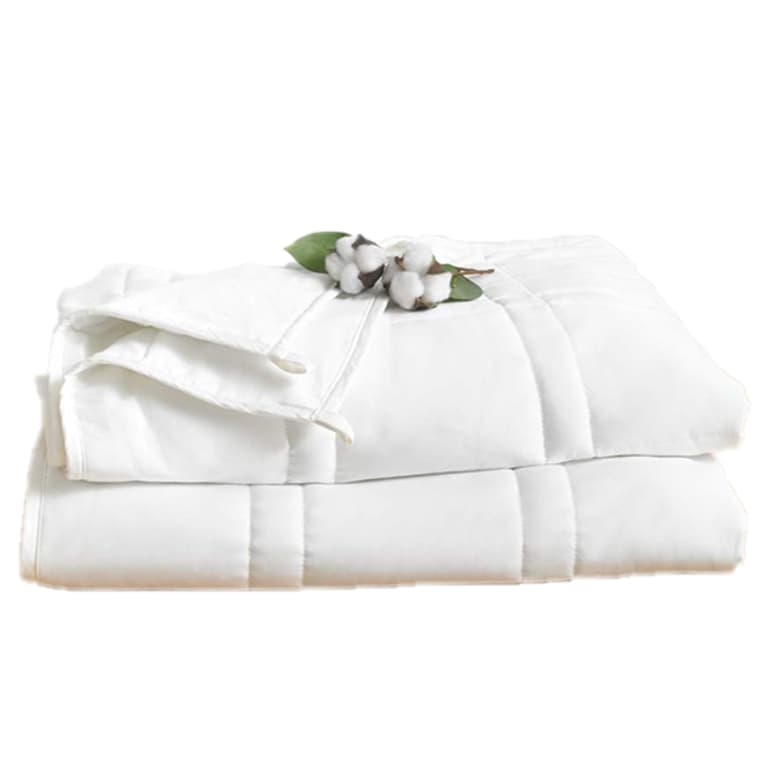 White weighted blanket, folded, with a piece of cotton placed on top.