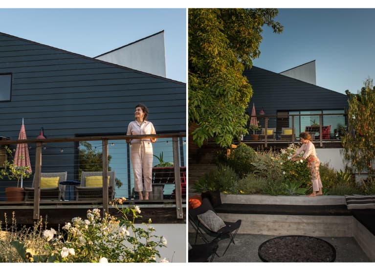 woman in front of modern home watering the landscaping