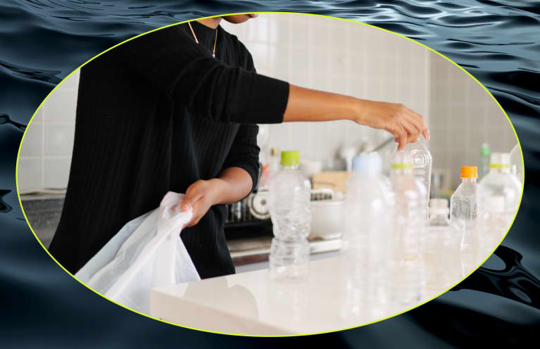 woman clearing plastic bottles at home