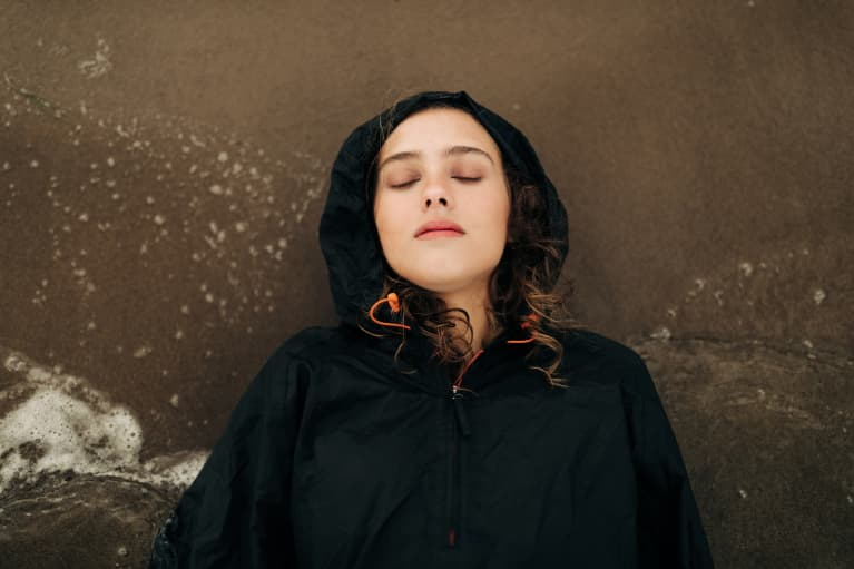 Young woman lying down stressed