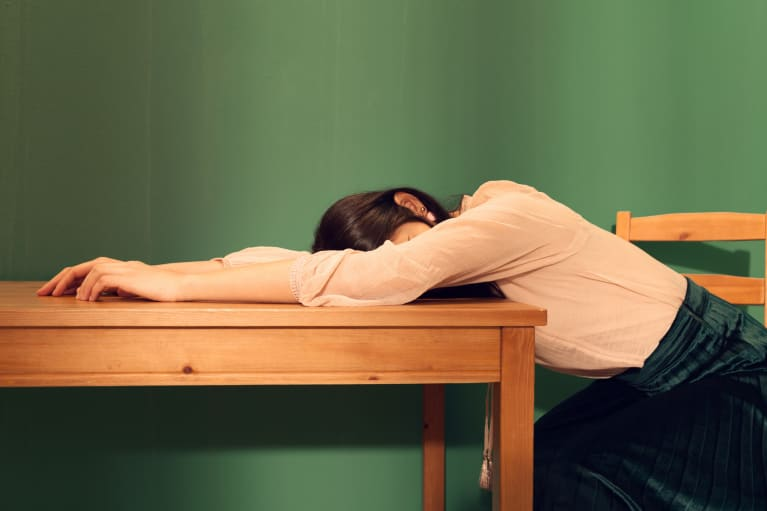 Tired Woman Sleeping On A Table