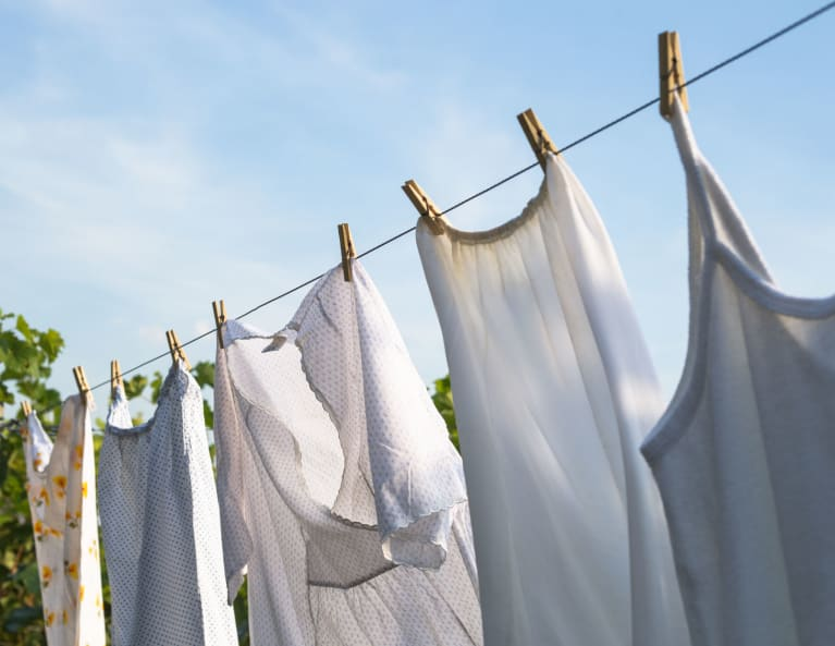 White Laundry Hanging To Dry On A Clothes-Line