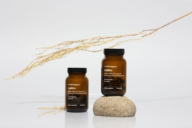 two brown supplement bottles in front of straw