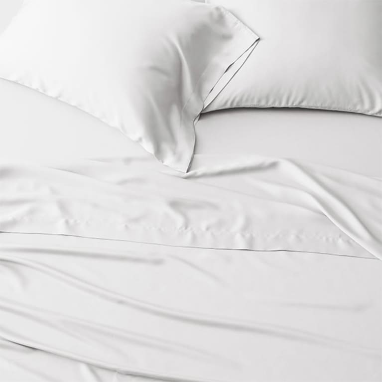 white sheets on bed